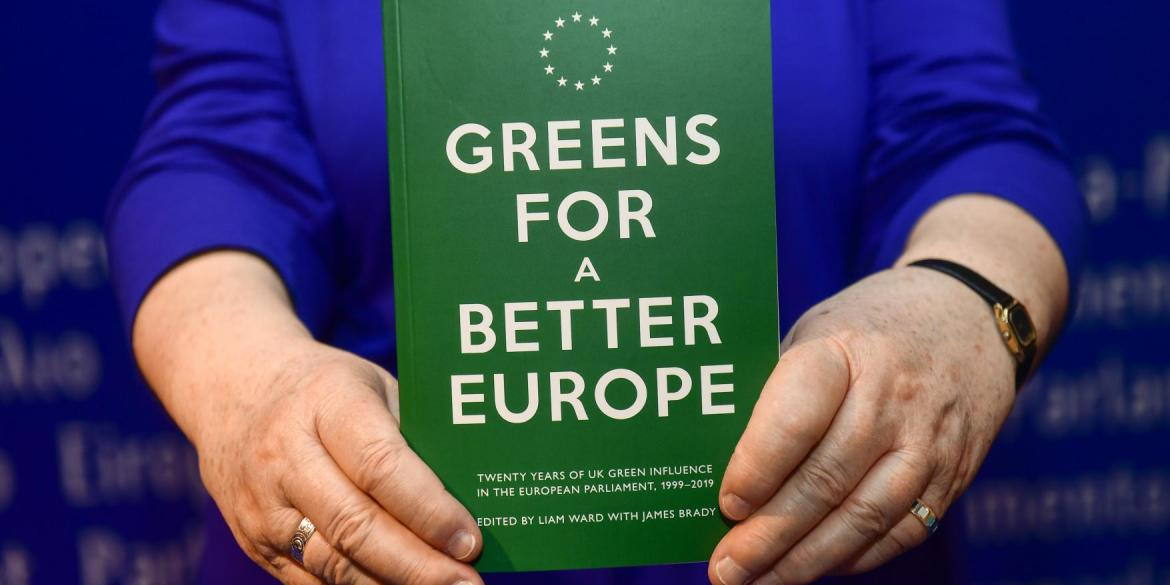 Jean Lambert MEP holds up a copy of the 'Greens for a Better Europe' book